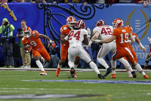 Clemson returner Travis Etienne (9) returns the opening kickoff in the first half of the Sugar Bowl semi-final playoff game against Alabama for the NCAA college football national championship, in New Orleans, Monday, Jan. 1, 2018. (AP Photo/Gerald Herbert)