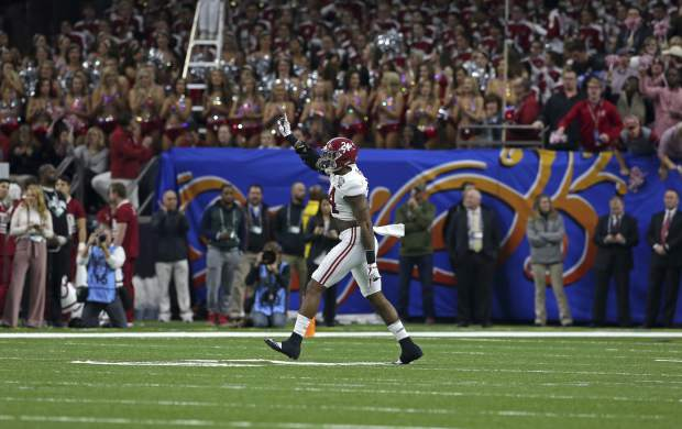 Alabama linebacker Terrell Lewis (24) celebrates a defensive stop in the first half of the Sugar Bowl semi-final playoff game against Clemson for the NCAA college football national championship, in New Orleans, Monday, Jan. 1, 2018. (AP Photo/Rusty Costanza)