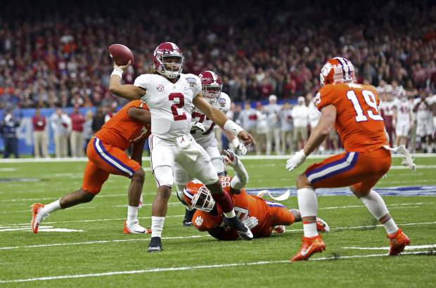 Alabama quarterback Jalen Hurts (2) throws a touchdown pass in the first half of the Sugar Bowl semi-final playoff game against Clemson for the NCAA college football national championship, in New Orleans, Monday, Jan. 1, 2018. (AP Photo/Rusty Costanza)