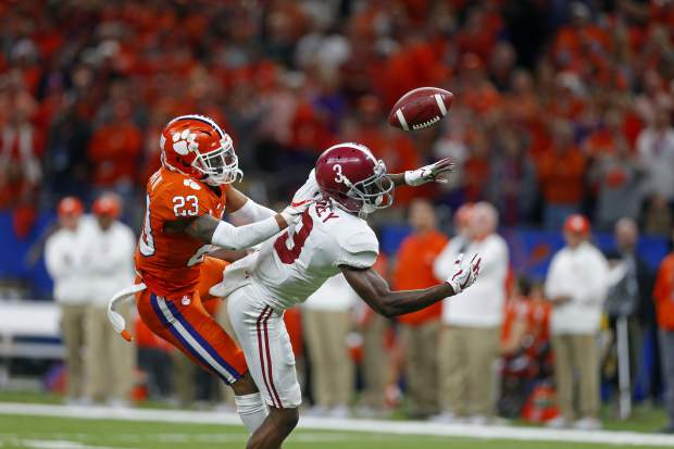 Clemson safety Van Smith (23) breaks up a pass intended for Alabama wide receiver Calvin Ridley (3) in the first half of the Sugar Bowl semi-final playoff game for the NCAA college football national championship, in New Orleans, Monday, Jan. 1, 2018. (AP Photo/Butch Dill)
