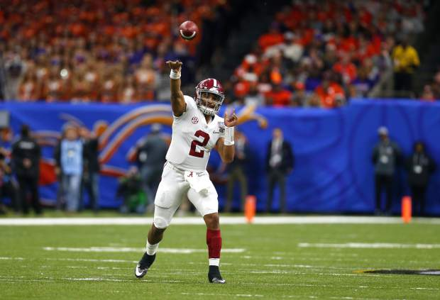 Alabama quarterback Jalen Hurts (2) passes in the first half of the Sugar Bowl semi-final playoff game against Clemson for the NCAA college football national championship, in New Orleans, Monday, Jan. 1, 2018. (AP Photo/Butch Dill)