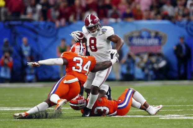 Alabama running back Josh Jacobs (8) carries as Clemson linebacker Kendall Joseph (34) tries to tackle in the first half of the Sugar Bowl semi-final playoff game for the NCAA college football national championship, in New Orleans, Monday, Jan. 1, 2018. (AP Photo/Butch Dill)