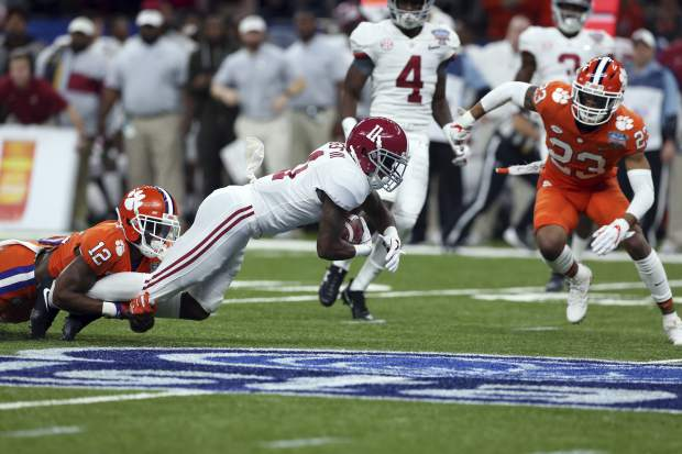 Clemson defensive back K'Von Wallace (12) tackles Alabama wide receiver Henry Ruggs III (11) in the first half of the Sugar Bowl semi-final playoff game for the NCAA college football national championship, in New Orleans, Monday, Jan. 1, 2018. (AP Photo/Rusty Costanza)