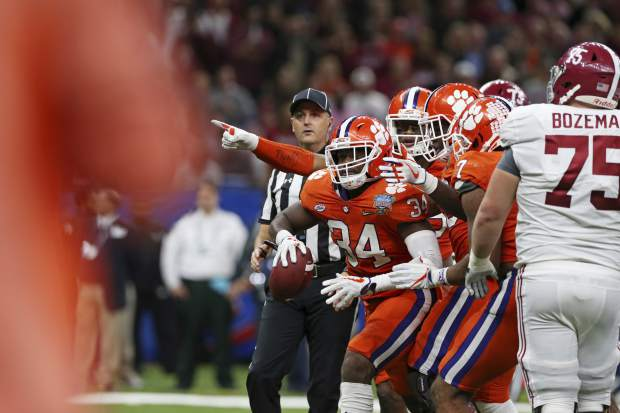 Clemson linebacker Kendall Joseph (34) celebrates a fuel recovery with teammates in the second half of the Sugar Bowl semi-final playoff game against Alabama for the NCAA college football national championship, in New Orleans, Monday, Jan. 1, 2018. (AP Photo/Rusty Costanza)