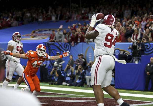 Alabama defensive lineman Da'Ron Payne (94), who was used on an offensive play, pulls in a touchdown reception in the second half of the Sugar Bowl semi-final playoff game against Clemson for the NCAA college football national championship, in New Orleans, Monday, Jan. 1, 2018. (AP Photo/Rusty Costanza)
