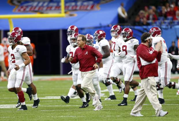 Alabama head coach Nick Saban takes to the field with his team before the Sugar Bowl semi-final playoff game against Clemson for the NCAA college football national championship, in New Orleans, Monday, Jan. 1, 2018. (AP Photo/Butch Dill)