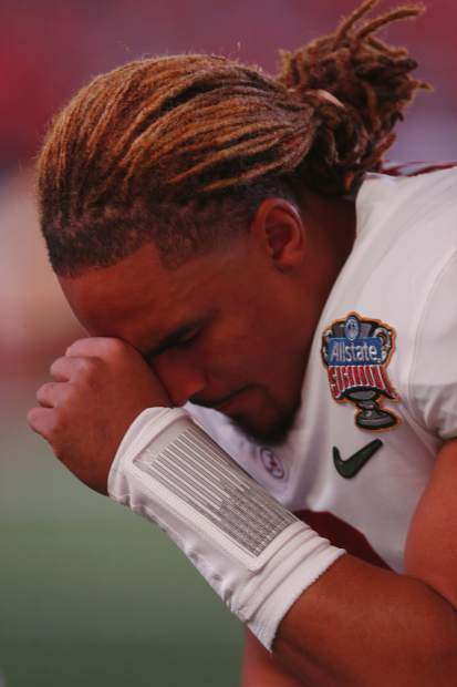 Alabama quarterback Jalen Hurts pauses before the Sugar Bowl semi-final playoff game against Clemson for the NCAA college football national championship, in New Orleans, Monday, Jan. 1, 2018. (AP Photo/Butch Dill)