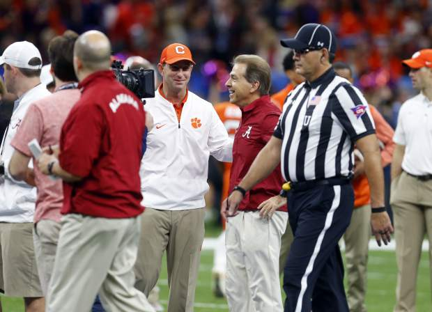 Clemson head coach Dabo Swinney and Alabama head coach Nick Saban, right, talk before the Sugar Bowl semi-final playoff game for the NCAA college football national championship, in New Orleans, Monday, Jan. 1, 2018. (AP Photo/Butch Dill)