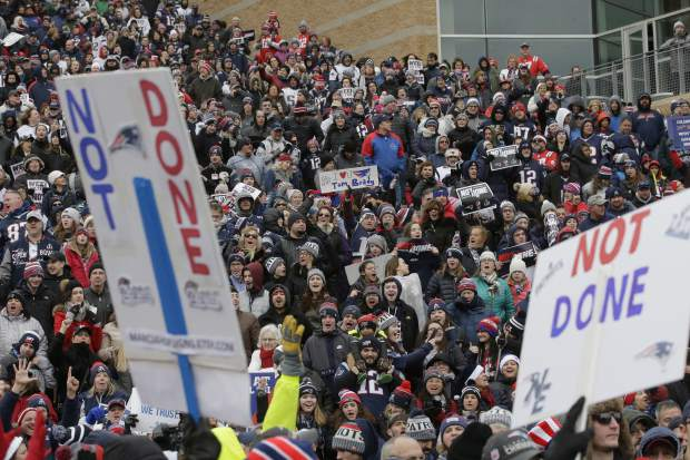 New England Patriots fans hold placards and cheer during an NFL football Super Bowl send-off rally for the team, Monday, Jan. 29, 2018, in Foxborough, Mass. The Patriots are to play the Philadelphia Eagles in Super Bowl 52, Sunday, Feb. 4, in Minneapolis. (AP Photo/Steven Senne)