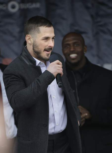 New England Patriots wide receiver Danny Amendola, left, addresses the crowd as free safety Devin McCourty, right, looks on during an NFL football Super Bowl send-off rally, Monday, Jan. 29, 2018, in Foxborough, Mass. The Patriots are to play the Philadelphia Eagles in Super Bowl 52, Sunday, Feb. 4, in Minneapolis. (AP Photo/Steven Senne)