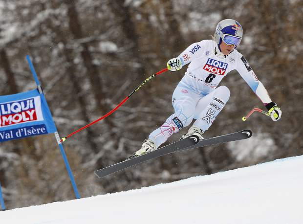 FILE - In this Dec. 16, 2017, file photo, United States' Lindsey Vonn competes during a women's World Cup super-G race in Val d'Isere, France. Vonn has some unfinished business on her agenda as she heads to the Pyeongchang Olympics. That includes trying to win more medals after missing the last Olympics because of a bad knee. (AP Photo/Gabriele Facciotti, File)