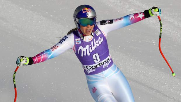 FILE- In this Saturday, Jan. 20, 2018, file photo, United States' Lindsey Vonn reacts in the finish area after finishing her run in the women's World Cup downhill ski race in Cortina D'Ampezzo, Italy. Vonn has some unfinished business on her agenda as she heads to the Pyeongchang Olympics. That includes trying to win more medals after missing the last Olympics because of a bad knee. (AP Photo/Alessandro Trovati, File)
