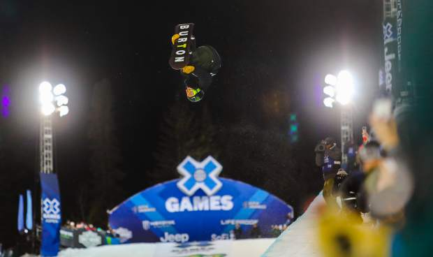 Ayumu Hirano flies through the air during his first run of the Men's Snowboard Superpipe Finals during the X Games on Sunday, Jan. 28, in Aspen, Colo. Hirano placed first with a score of 99 out of 100. (AP Photo/Vail Daily Chris Dillmann)