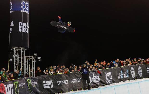 Scotty James goes big during the during his first run of the Men's Snowboard Superpipe Finals during the X Games on Sunday, Jan. 28, in Aspen. James placed second with a 98.