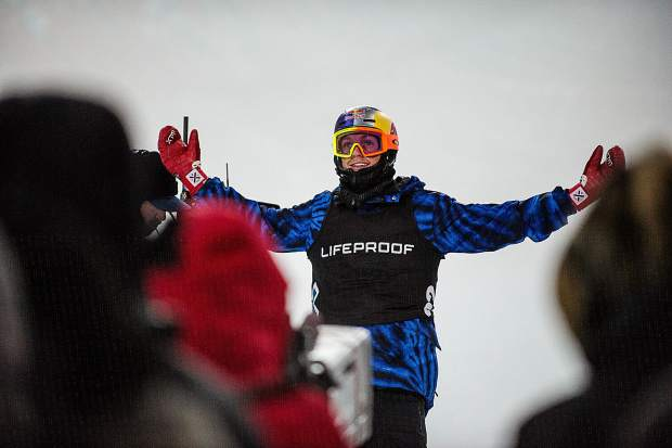 Australian snowboarder Scotty James raises his arms up after landing a very clean third run. James took second with a 98 just after Japanese rider Ayumu Hirano.