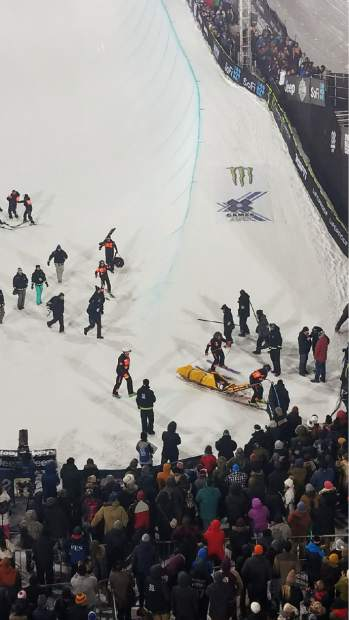 Medical crews rush Iouri Podladtchikov from the superpipe on Sunday night after the Swiss snowboarder crash hard on his final hit of his second round in the finals. He sustained nasal fractures but CT scans were negative for back and neck injuries.