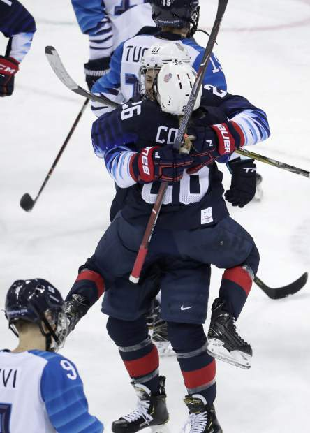 Kendall Coyne (26), of the United States, jumps on Hilary Knight (21) to celebrate after Knight scores a goal against Finland during the second period of the semifinal round of the women's hockey game at the 2018 Winter Olympics in Gangneung, South Korea, Monday, Feb. 19, 2018. (AP Photo/Julio Cortez)