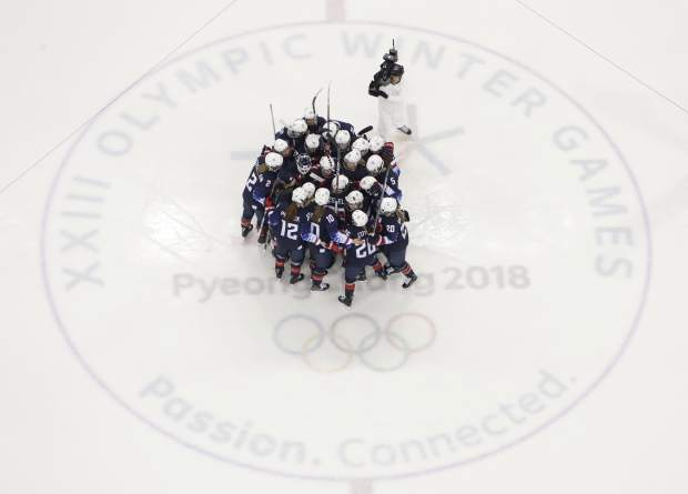 The United States players celebrate after the semifinal round of the women's hockey game against Finland at the 2018 Winter Olympics in Gangneung, South Korea, Monday, Feb. 19, 2018. the United States won 5-0. (AP Photo/Julio Cortez)