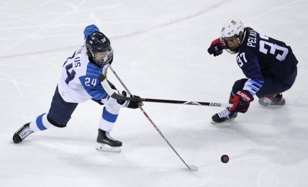 Noora Tulus (24), of Finland, passes the puck past Amanda Pelkey (37), of the United States, during the first period of the semifinal round of the women's hockey game at the 2018 Winter Olympics in Gangneung, South Korea, Monday, Feb. 19, 2018. (AP Photo/Julio Cortez)