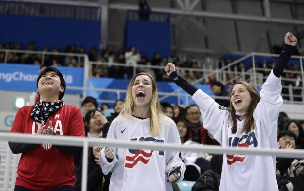 Fans cheer after Gigi Marvin (19), of the United States, scores a goal against Finland during the first period of the semifinal round of the women's hockey game at the 2018 Winter Olympics in Gangneung, South Korea, Monday, Feb. 19, 2018. (AP Photo/Matt Slocum)
