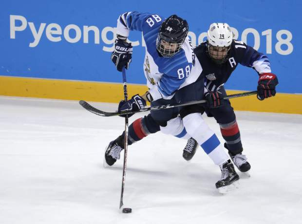 Ronja Savolainen, of Finland, and Brianna Decker (14), of the United States, battle for the puck during the first period of the semifinal round of the women's hockey game at the 2018 Winter Olympics in Gangneung, South Korea, Monday, Feb. 19, 2018. (AP Photo/Julio Cortez)