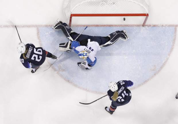 The puck shot by Jocelyne Lamoureux-Davidson, of the United States, sails past goalie Noora Raty (41), of Finland, for a goal during the second period of the semifinal round of the women's hockey game at the 2018 Winter Olympics in Gangneung, South Korea, Monday, Feb. 19, 2018. (AP Photo/Matt Slocum)