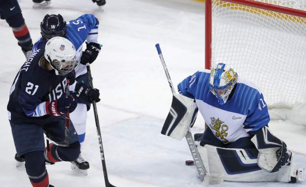 Hilary Knight (21), of the United States, shoots the puck past goalie Noora Raty (41), of Finland, for a goal during the second period of the semifinal round of the women's hockey game at the 2018 Winter Olympics in Gangneung, South Korea, Monday, Feb. 19, 2018. (AP Photo/Julio Cortez)