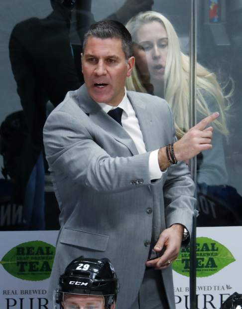 Colorado Avalanche head coach Jared Bednar directs his team against the Vancouver Canucks in the first period of an NHL hockey game Monday, Feb. 26, 2018, in Denver. (AP Photo/David Zalubowski)