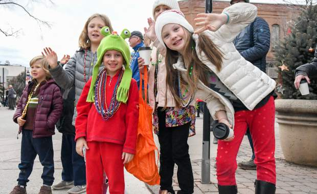 Kids collect as many beads as possible during Carbondale' Fat First Friday Parade down Main Street.