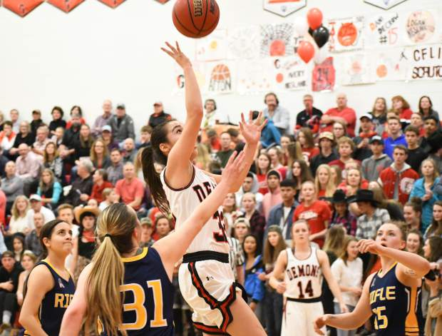 Glenwood Springs Demon Ximena Guiterrez jumps for the lay up during Thursday night's game against the Rifle Bears.