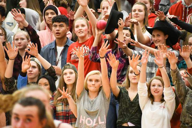 The Glenwood Springs student section raise their hands during the rival game against the Rifle Bears on Thursday night at Glenwood Springs High School.