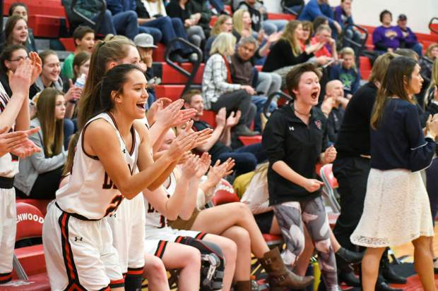 The Glenwood Springs bench cheers for the team during Tuesday night's playoff matchup with Mountain View.