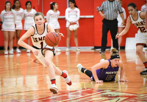 Glenwood Springs senior point guard Maddie Bolitho steals the ball away from the Mountain View Mountain Lions during Tuesday night's playoff game at Glenwood Springs High School.