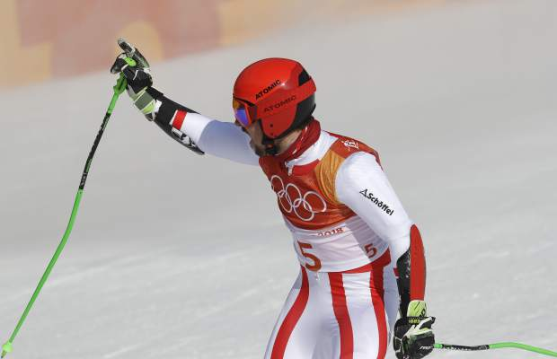 Austria's Marcel Hirscher celebrates after winning the gold medal following the second run of the men's giant slalom at the 2018 Winter Olympics in Pyeongchang, South Korea, Sunday, Feb. 18, 2018. (AP Photo/Michael Probst)