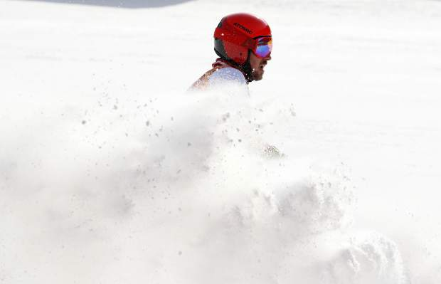 Austria's Marcel Hirscher comes to a halt in the finish area after winning the gold medal following the second run of the men's giant slalom at the 2018 Winter Olympics in Pyeongchang, South Korea, Sunday, Feb. 18, 2018. (AP Photo/Christophe Ena)