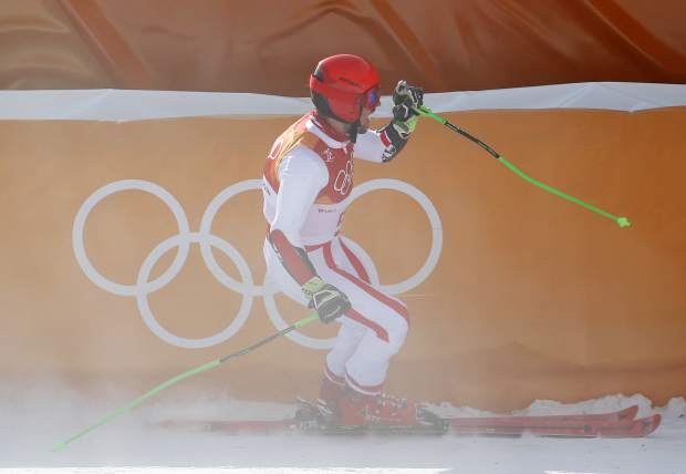 Austria's Marcel Hirscher celebrates after winning the gold medal following the second run of the men's giant slalom at the 2018 Winter Olympics in Pyeongchang, South Korea, Sunday, Feb. 18, 2018. (AP Photo/Christophe Ena)