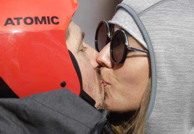 Austria's Marcel Hirscher kisses his girlfriend Laura Moisl after winning the gold medal in the men's giant slalom at the 2018 Winter Olympics in Pyeongchang, South Korea, Sunday, Feb. 18, 2018. (AP Photo/Michael Probst)