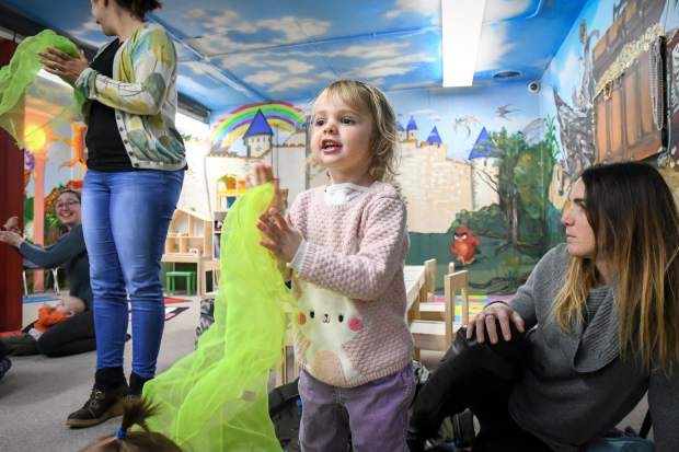 Two-year-old Catalina Drake claps and sings along during the interactive storytime at the Glenwood Toys and Gifts store on Tuesday. Storytime is a weekly event put on by the Glenwood Springs Branch Library and will be going