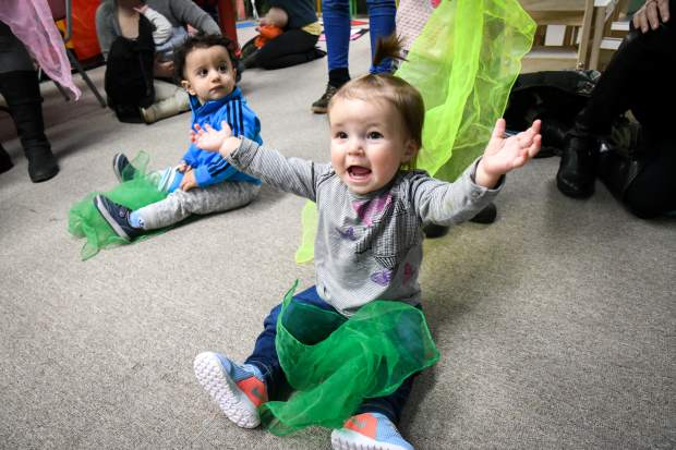 One-year-old Afton Langenhuizen gets excited during interactive storytime at Glenwood Toys and Gifts put on by the Glenwood Springs Branch Library.