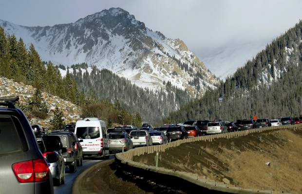 In this Jan. 7, 2018, photo, traffic backs up on Interstate 70 in Colorado, a familiar scene on the main highway connecting Denver to the mountains The chairman of a committee exploring whether Denver should bid on the 2030 Olympics says buses or giving incentives to truckers to avoid the highway could help keep traffic moving if the city hosted the games. Rob Cohen also says a possible surplus could help pay to improve the highway later. (AP Photo/Thomas Peipert)