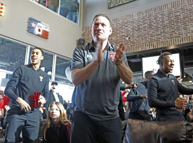 Texas Tech coach Chris Beard celebrates after finding out where the Red Raiders will play during a watch party for the NCAA basketball tournament Sunday, March 11, 2018, in Lubbock, Texas. (Brad Tollefson/Lubbock Avalanche-Journal via AP)/Lubbock Avalanche-Journal via AP)