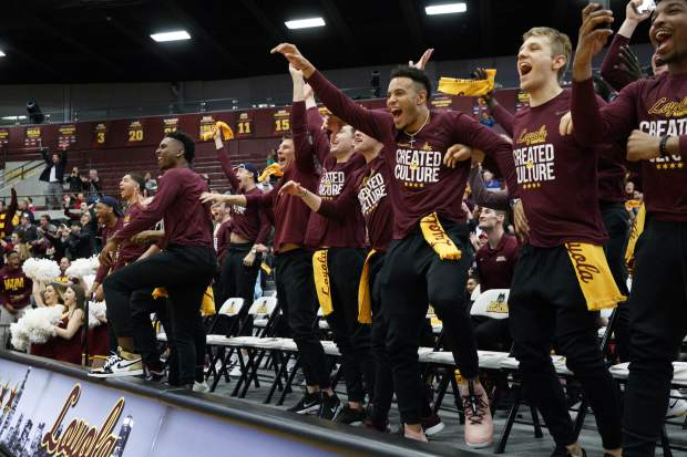 Loyola men's basketball players celebrate after the team was selected to play in the NCAA Tournament during a selection show watch party at Gentile Arena Sunday, March 11, 2018 in Chicago. (Armando L. Sanchez/Chicago Tribune via AP)