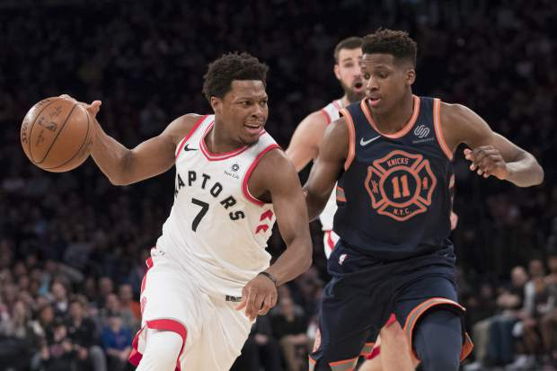 Toronto Raptors guard Kyle Lowry (7) drives to the basket against New York Knicks guard Frank Ntilikina (11) during the first half of an NBA basketball game, Sunday, March 11, 2018, at Madison Square Garden in New York. (AP Photo/Mary Altaffer)