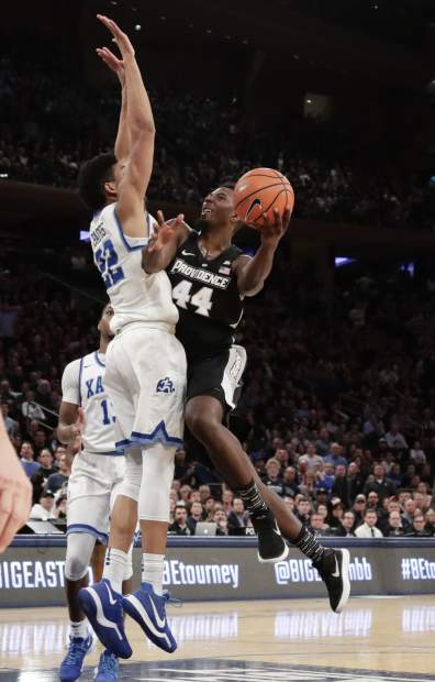Providence's Isaiah Jackson (44) drives past Xavier's Kaiser Gates (22) during overtime of an NCAA college basketball game in the Big East men's tournament semifinals Friday, March 9, 2018, in New York. (AP Photo/Frank Franklin II)