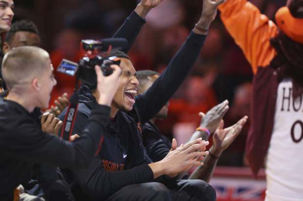 Kerry Blackshear Jr. (24) center, and his teammates react to Virginia Tech being selected during a NCAA Tournament selection show watch party in Cassell Coliseum in Blacksburg, Va. Sunday, March 11, 2018. (Matt Gentry/The Roanoke Times via AP)