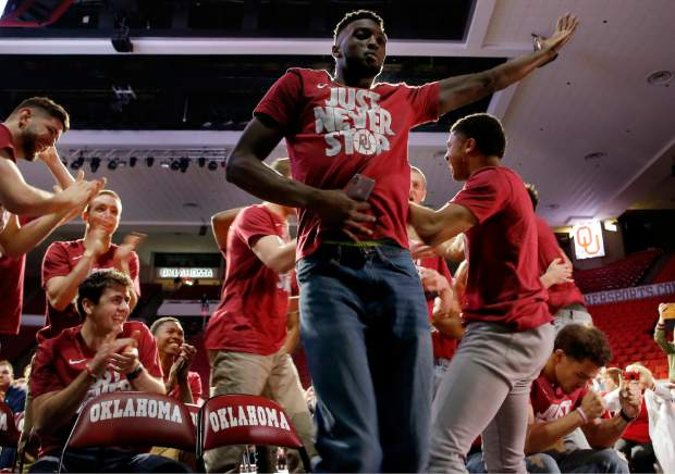 Oklahoma's Khadeem Lattin celebrates during a watch party for the NCAA selection show at Lloyd Noble Center in Norman, Okla., Sunday, March 11, 2018. (Sarah Phipps/The Oklahoman via AP)