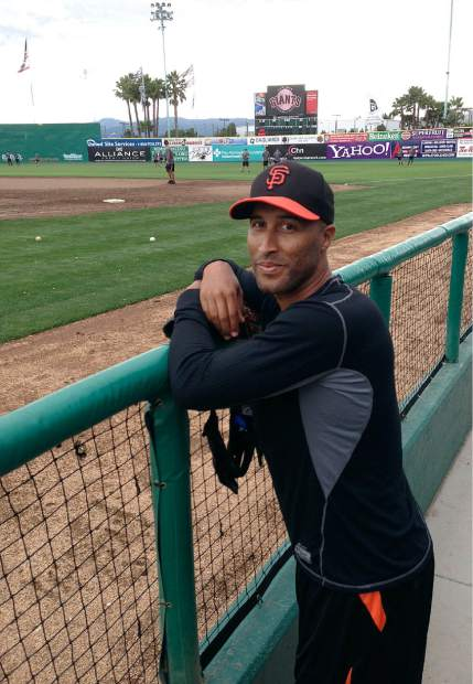 FILE - In this June 24, 2013, file photo, former San Francisco Giants outfielder Randy Winn poses for photographs in the dugout at Municipal Stadium before a Class-A minor league baseball game between the San Jose Giants and the Modesto Nuts in San Jose, Calif. As baseball begins anew, many former players still find it somewhat tough to see the game go on without them. Winn explains how the regimented baseball schedule always has players somewhere at a specific time, from buses to flights to stretching and batting practice. And that's often all you know and have known for years. (AP Photo/Janie McCauley, File)