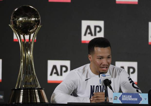 Villanova's Jalen Brunson answers questions with his AP Player of the Year trophy at a news conference at the Final Four NCAA college basketball tournament, Thursday, March 29, 2018, in San Antonio. (AP Photo/David J. Phillip)