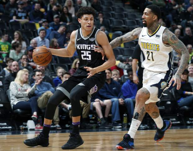 Sacramento Kings forward Justin Jackson, left, drives to the basket as Denver Nuggets forward Wilson Chandler defends in the first half of an NBA basketball game Sunday, March 11, 2018, in Denver. (AP Photo/David Zalubowski)