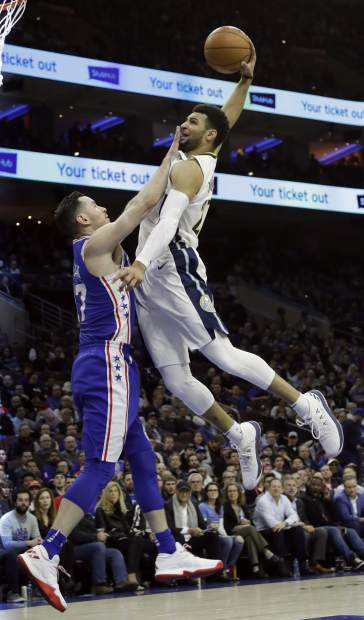 Denver Nuggets' Jamal Murray, right, goes up for a dunk against Philadelphia 76ers' JJ Redick during the first half of an NBA basketball game, Monday, March 26, 2018, in Philadelphia. (AP Photo/Matt Slocum)